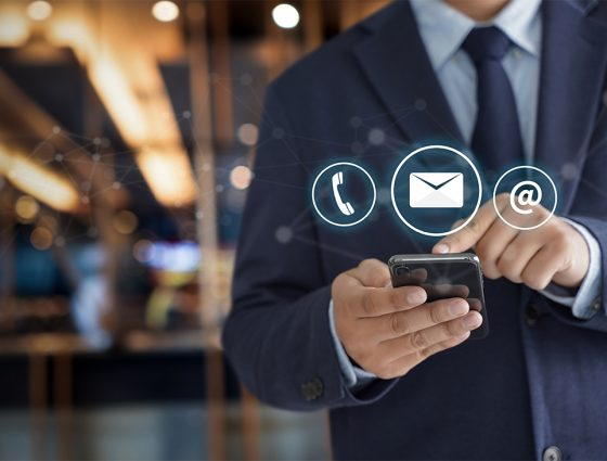 contact-us-hand-businessman-holding-mobile-smartphone-with-mail-phone-email-icon